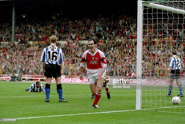 Steve Morrow of Arsenal celebrates after scoring the winning goal during the Coca Cola Cup final against Sheffield Wednesday at Wembley Stadium in...