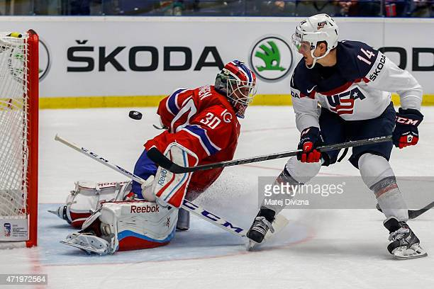 Steve Moses of USA tries to score against Lars Haugen goalkeeper of Norway during the IIHF World Championship group B match between Norway and USA at...
