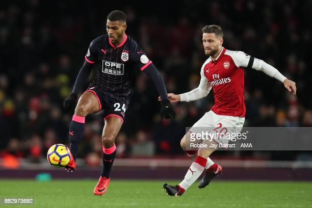 Steve Mounie of Huddersfield Town and Shkodran Mustafi of Arsenal during the Premier League match between Arsenal and Huddersfield Town at Emirates...