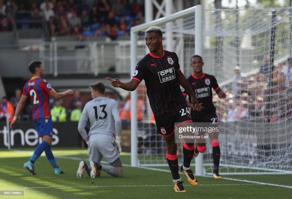 Steve Mounie of Huddersfield Town celebrates scoring his sides third goal during the Premier League match between Crystal Palace and Huddersfield Town at Selhurst Park on August 12, 2017 in London, England.