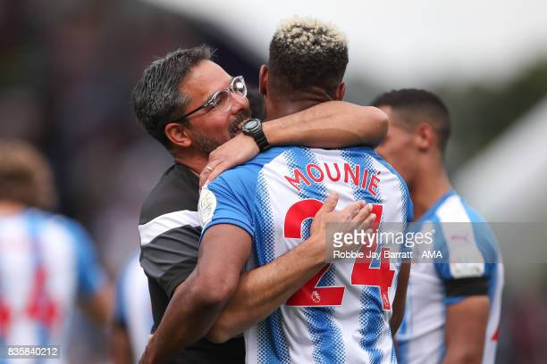 Steve Mounie of Huddersfield Town celebrates with David Wagner head coach / manager of Huddersfield Town at full time during the Premier League match...