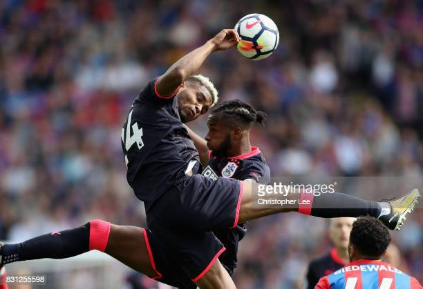 Steve Mounie of Huddersfield Town goes for the ball with Kasey Palmer of Huddersfield Town during the Premier League match between Crystal Palace and...