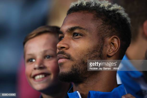 Steve Mounie of Huddersfield Town has a photo with a fan prior to the Carabao Cup Second Round match between Huddersfield Town and Rotherham United...