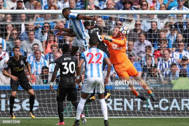 Steve Mounie of Huddersfield Town heads towards goal during the Premier League match between Huddersfield Town and Newcastle United at Galpharm...
