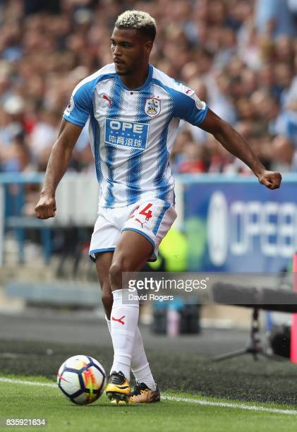 Steve Mounie of Huddersfield Town runs with the ball during the Premier League match between Huddersfield Town and Newcastle United at John Smith's...