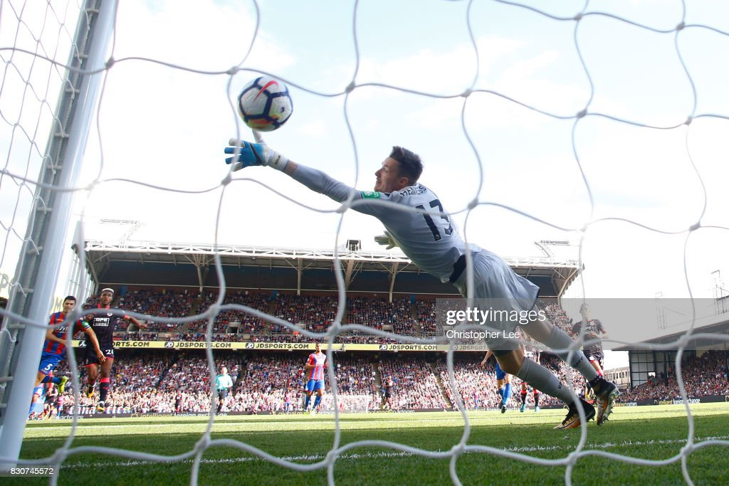 Steve Mounie of Huddersfield Town scores his sides third goal past goalkeeper Wayne Hennessey of Crystal Palace during the Premier League match between Crystal Palace and Huddersfield Town at Selhurst Park on August 12, 2017 in London, England.