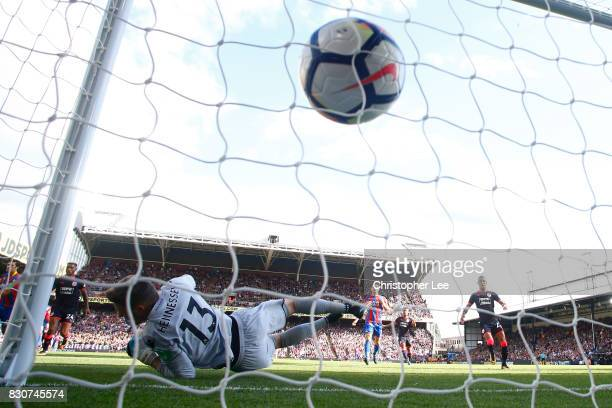 Steve Mounie of Huddersfield Town scores his sides third goal past goalkeeper Wayne Hennessey of Crystal Palace during the Premier League match...