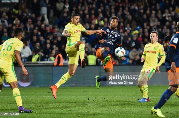 Steve Mounie of Montpellier and Diego Santos Silva of Nantes during the Ligue 1 match between Montpellier Herault and Fc Nantes at Stade de la Mosson...