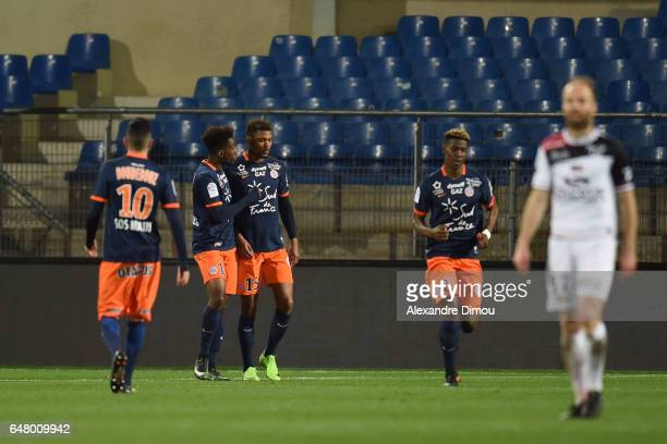 Steve Mounie of Montpellier celebrates his Goal with Isaac Mbenza during the French Ligue 1 match between Montpellier and Guingamp at Stade de la...