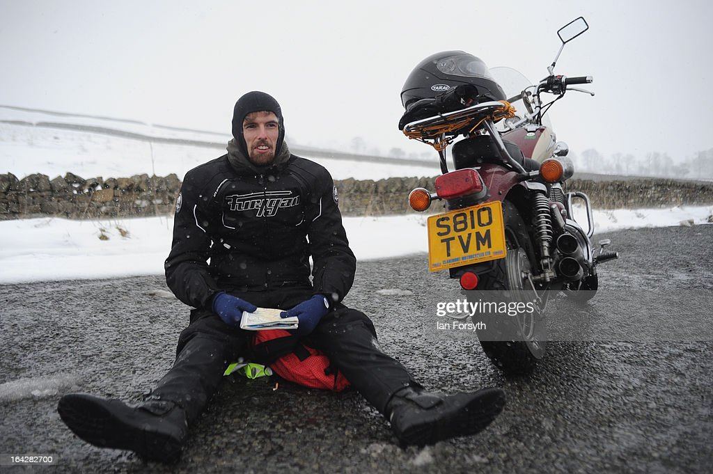 Steve Moyle is forced to wait for the road to reopen as heavy snow caused the closure of the A66 on March 22, 2013 in Bowes, United Kingdom. Heavy snow is causing disruption to transport and schools across the UK in the coldest March the country has seen for decades, with no sign of the warm spring weather that Britain enjoyed this time last year. Homes have been left without power in Northern Ireland, airports shut and flooding in parts of Devon and Cornwall.