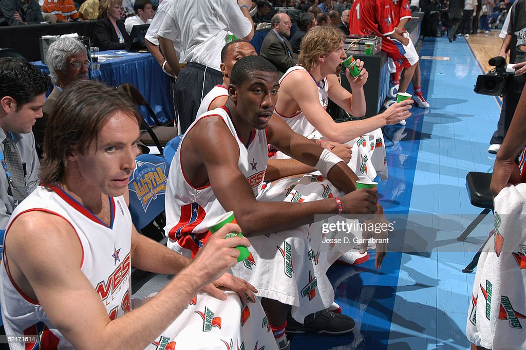 Steve Nash, Amare Stoudemire, Shawn Marion and Dirk Nowitzki of the Western Conference All-Stars look on from the bench during the 54th All-Star Game, part of 2005 NBA All-Star Weekend at Pepsi Center on February 20, 2005 in Denver, Colorado. The East defeated the West 125-115.