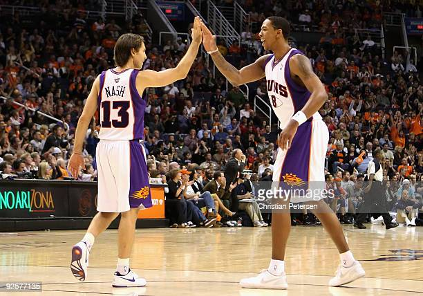 Steve Nash and Channing Frye of the Phoenix Suns highfive after scoring against the Golden State Warriors during the NBA game at US Airways Center on...