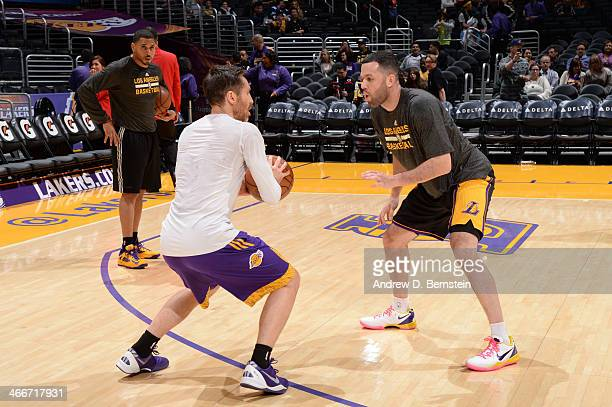 Steve Nash and Jordan Farmar of the Los Angeles Lakers warm up before a game against the Charlotte Bobcats at STAPLES Center on January 31 2014 in...