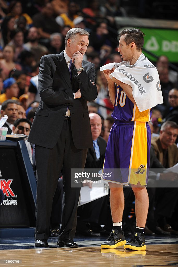 <a gi-track='captionPersonalityLinkClicked' href=/galleries/search?phrase=Steve+Nash&family=editorial&specificpeople=201513 ng-click='$event.stopPropagation()'>Steve Nash</a> #10 and <a gi-track='captionPersonalityLinkClicked' href=/galleries/search?phrase=Mike+D%27Antoni&family=editorial&specificpeople=203175 ng-click='$event.stopPropagation()'>Mike D'Antoni</a> of the Los Angeles Lakers discuss plays against the Denver Nuggets on December 26, 2012 at the Pepsi Center in Denver, Colorado.
