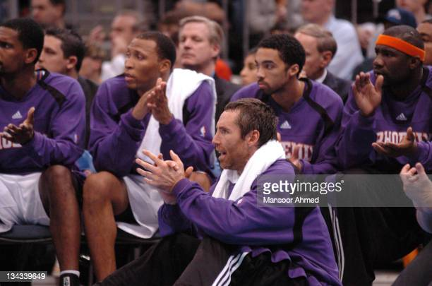 Steve Nash and the rest of his Phoenix Suns teammates cheers on from the bench during the NBA Europe Live Tour presented by EA Sports on October 11...
