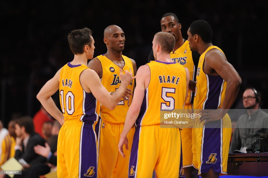 Steve Nash #10, Kobe Bryant #24, Steve Blake #5, Dwight Howard #12, and Metta World Peace #15 of the Los Angeles Lakers huddle together against the Minnesota Timberwolves at Staples Center on February 28, 2013 in Los Angeles, California.