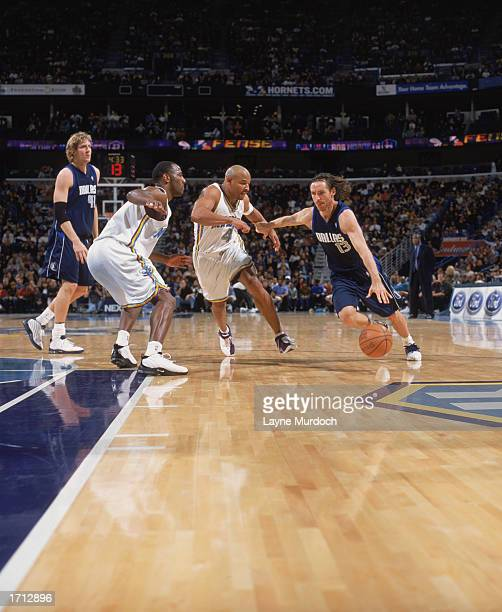 Steve Nash of the Dallas Mavericks drives to the basket against David Wesley of the New Orleans Hornets during the game at New Orleans Arena on...
