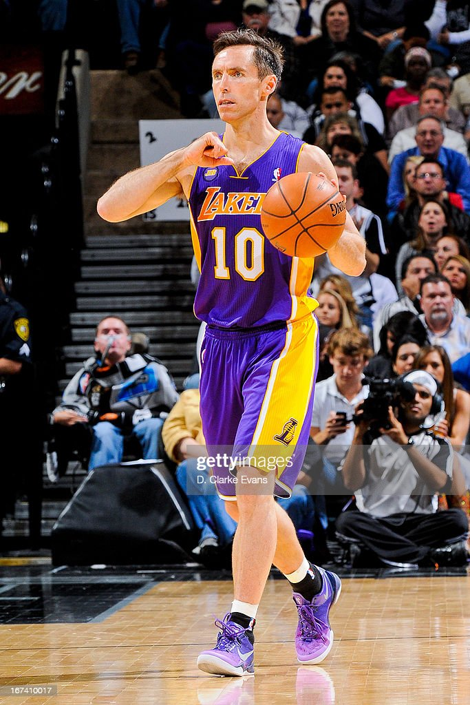 <a gi-track='captionPersonalityLinkClicked' href=/galleries/search?phrase=Steve+Nash&family=editorial&specificpeople=201513 ng-click='$event.stopPropagation()'>Steve Nash</a> #10 of the Los Angeles Lakers advances the ball against the San Antonio Spurs in Game Two of the Western Conference Quarterfinals during the 2013 NBA Playoffs on April 24, 2013 at the AT&T Center in San Antonio, Texas.