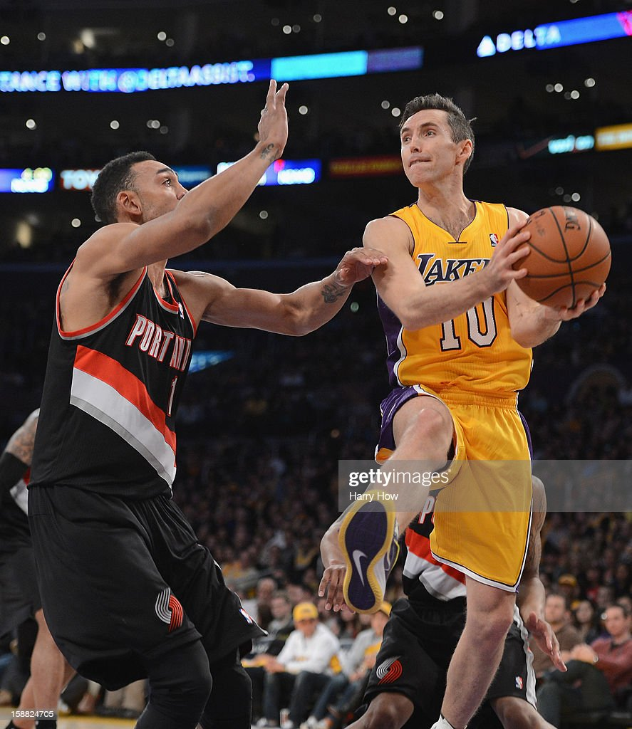 Steve Nash #10 of the Los Angeles Lakers attempts a layup in front of Jared Jeffries #1 of the Portland Trail Blazers at Staples Center on December 28, 2012 in Los Angeles, California. The Lakers won 104-87.