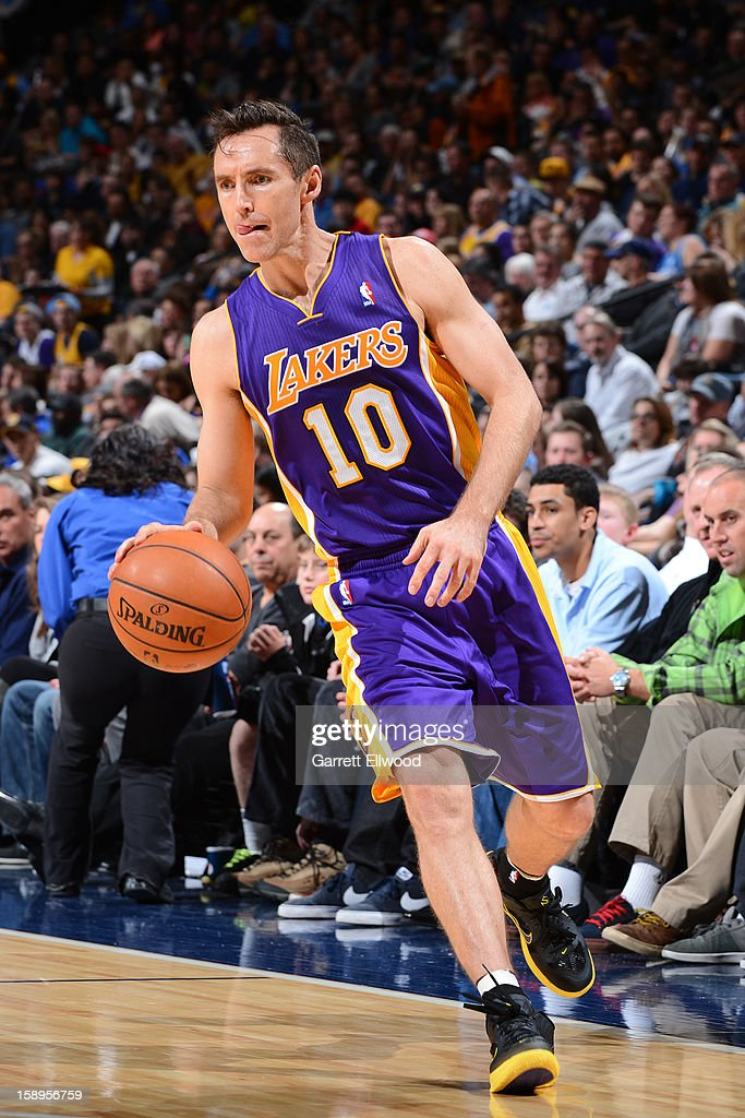 <a gi-track='captionPersonalityLinkClicked' href=/galleries/search?phrase=Steve+Nash+-+Basketball+Player&family=editorial&specificpeople=201513 ng-click='$event.stopPropagation()'>Steve Nash</a> #10 of the Los Angeles Lakers brings the ball up court against the Denver Nuggets on December 26, 2012 at the Pepsi Center in Denver, Colorado.