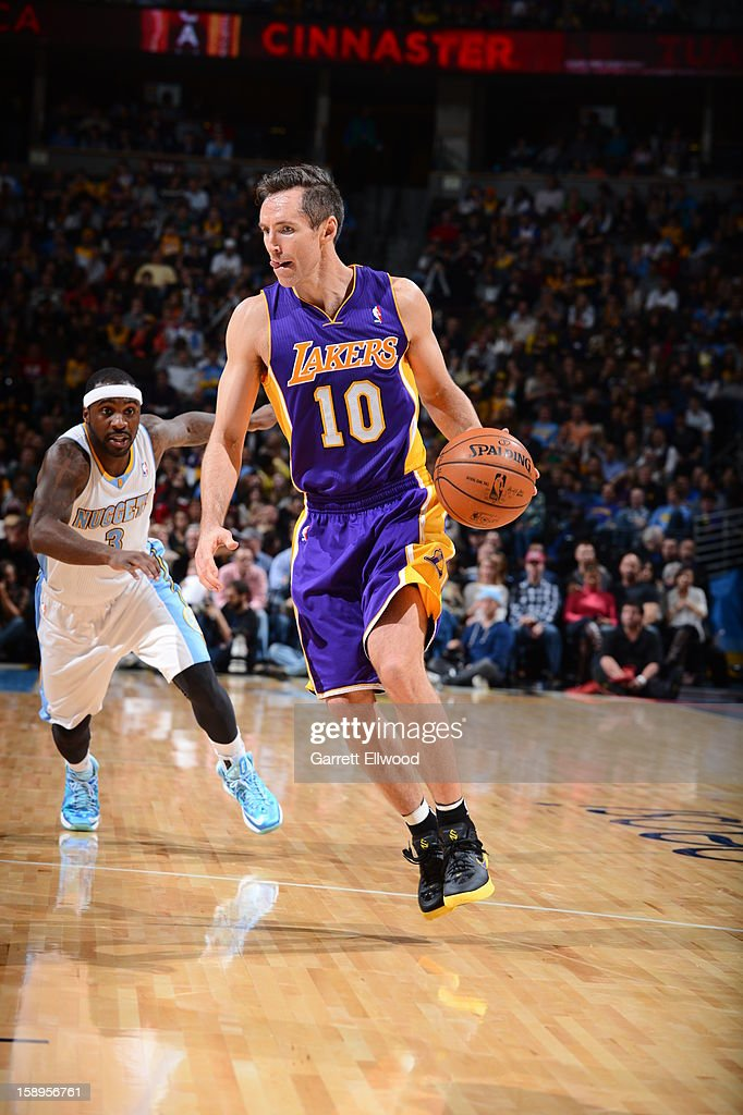 <a gi-track='captionPersonalityLinkClicked' href=/galleries/search?phrase=Steve+Nash&family=editorial&specificpeople=201513 ng-click='$event.stopPropagation()'>Steve Nash</a> #10 of the Los Angeles Lakers brings the ball up court against the Denver Nuggets on December 26, 2012 at the Pepsi Center in Denver, Colorado.