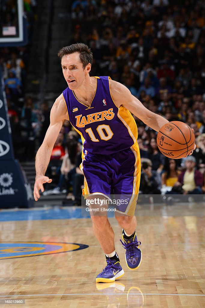 Steve Nash #10 of the Los Angeles Lakers brings the ball up court against the Denver Nuggets on February 25, 2013 at the Pepsi Center in Denver, Colorado.