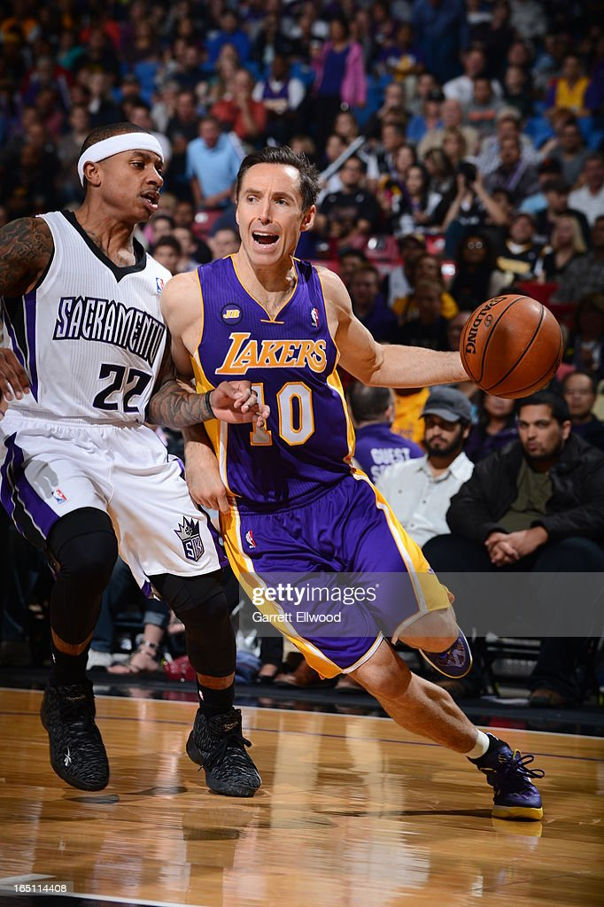Steve Nash #10 of the Los Angeles Lakers dribbles the ball around Isaiah Thomas #22 of the Sacramento Kings on March 30, 2013 at Sleep Train Arena in Sacramento, California.
