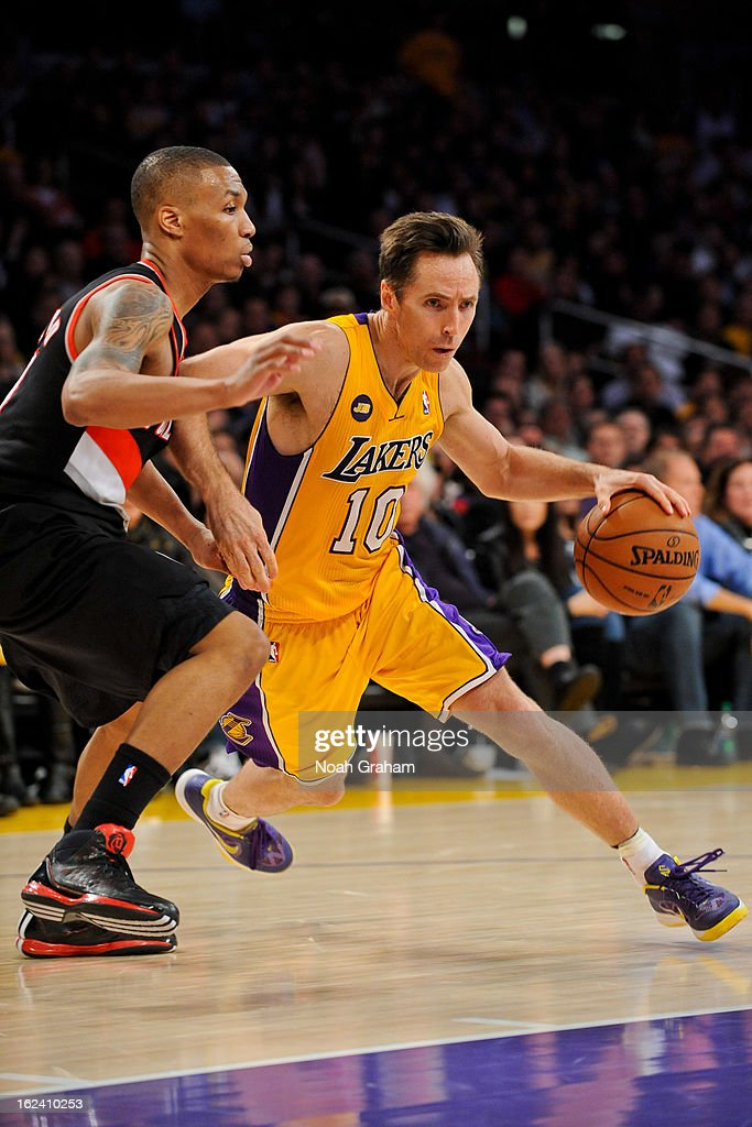 <a gi-track='captionPersonalityLinkClicked' href=/galleries/search?phrase=Steve+Nash&family=editorial&specificpeople=201513 ng-click='$event.stopPropagation()'>Steve Nash</a> #10 of the Los Angeles Lakers drives against <a gi-track='captionPersonalityLinkClicked' href=/galleries/search?phrase=Damian+Lillard&family=editorial&specificpeople=6598327 ng-click='$event.stopPropagation()'>Damian Lillard</a> #0 of the Portland Trail Blazers at Staples Center on February 22, 2013 in Los Angeles, California.