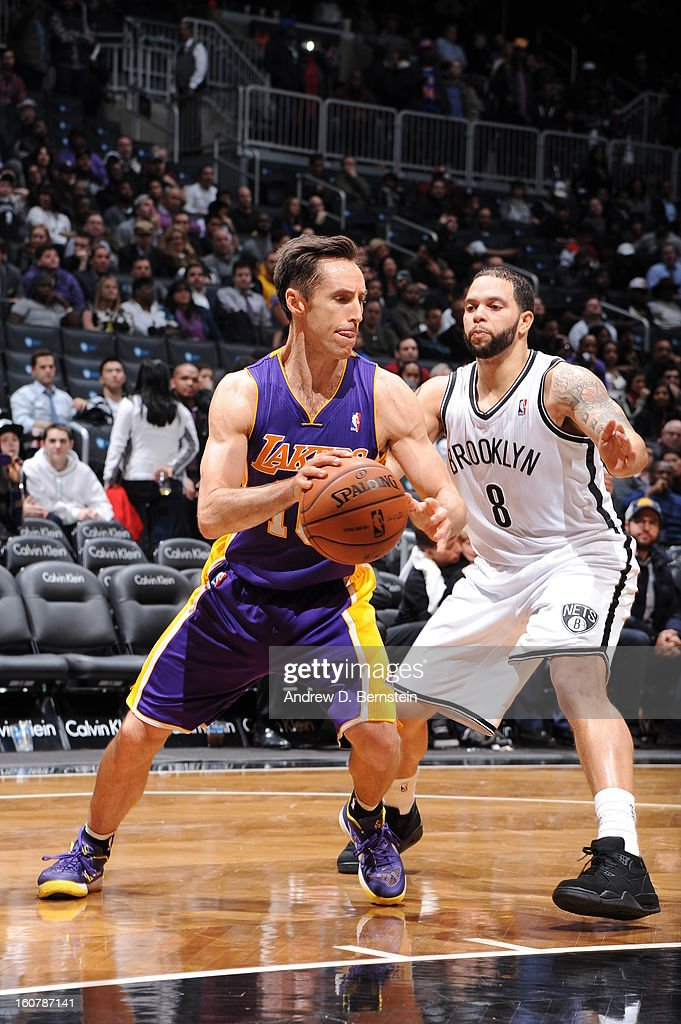 Steve Nash #10 of the Los Angeles Lakers drives against Deron Williams #8 of the Brooklyn Nets on February 5, 2013 at the Barclays Center in the Brooklyn borough of New York City.