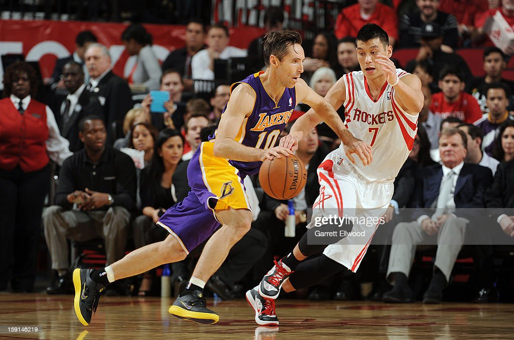 Steve Nash #10 of the Los Angeles Lakers drives against Jeremy Lin #7 of the Houston Rockets on January 8, 2013 at the Toyota Center in Houston, Texas.