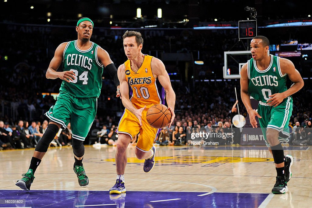 Steve Nash #10 of the Los Angeles Lakers drives against Paul Pierce #34 and Avery Bradley #0 of the Boston Celtics at Staples Center on February 20, 2013 in Los Angeles, California.