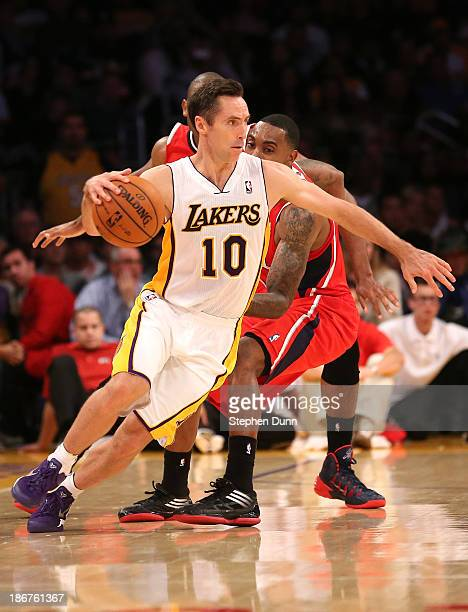 Steve Nash of the Los Angeles Lakers drives against the Atlanta Hawks at Staples Center on November 3 2013 in Los Angeles California The Lakers won...