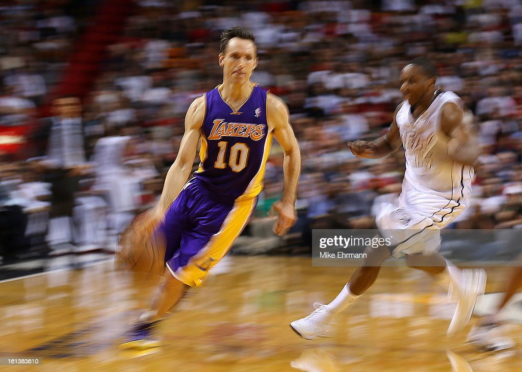 Steve Nash #10 of the Los Angeles Lakers drives around Mario Chalmers #15 of the Miami Heat during a game at American Airlines Arena on February 10, 2013 in Miami, Florida.