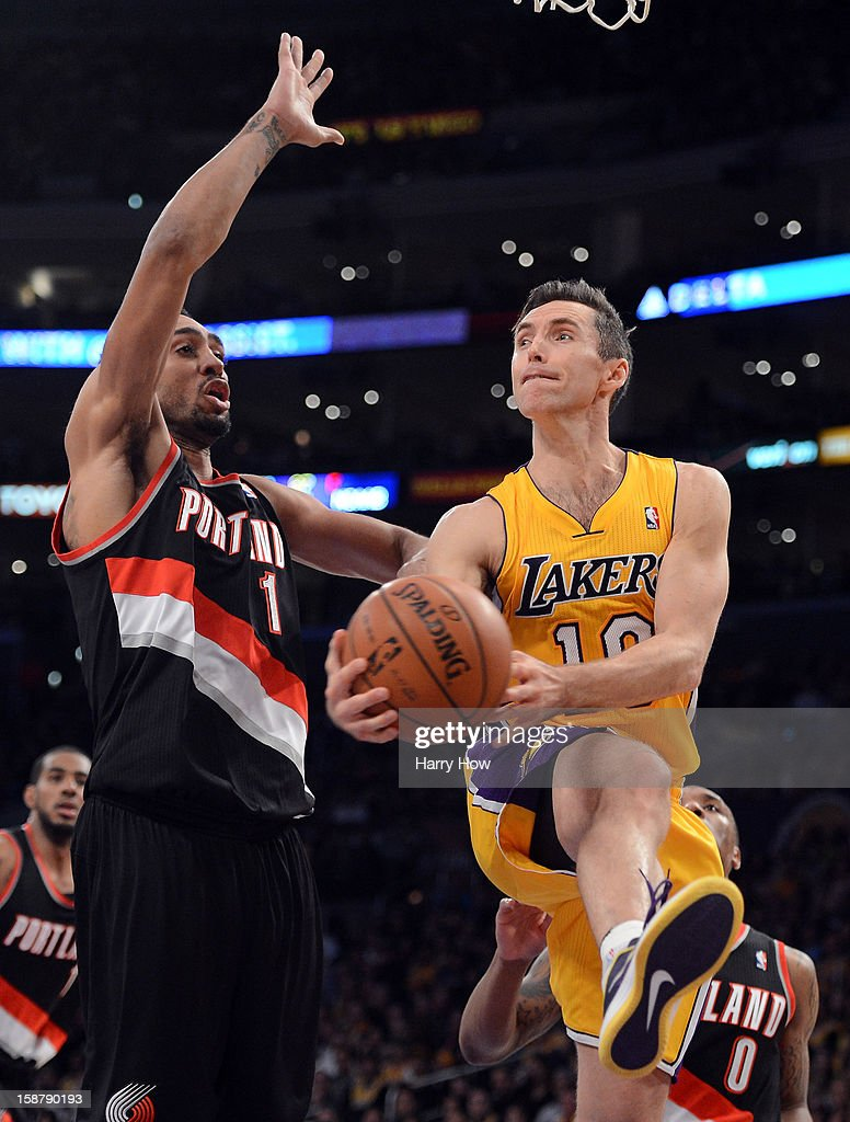 Steve Nash #10 of the Los Angeles Lakers drives on Jared Jeffries #1 of the Portland Trail Blazers at Staples Center on December 28, 2012 in Los Angeles, California.