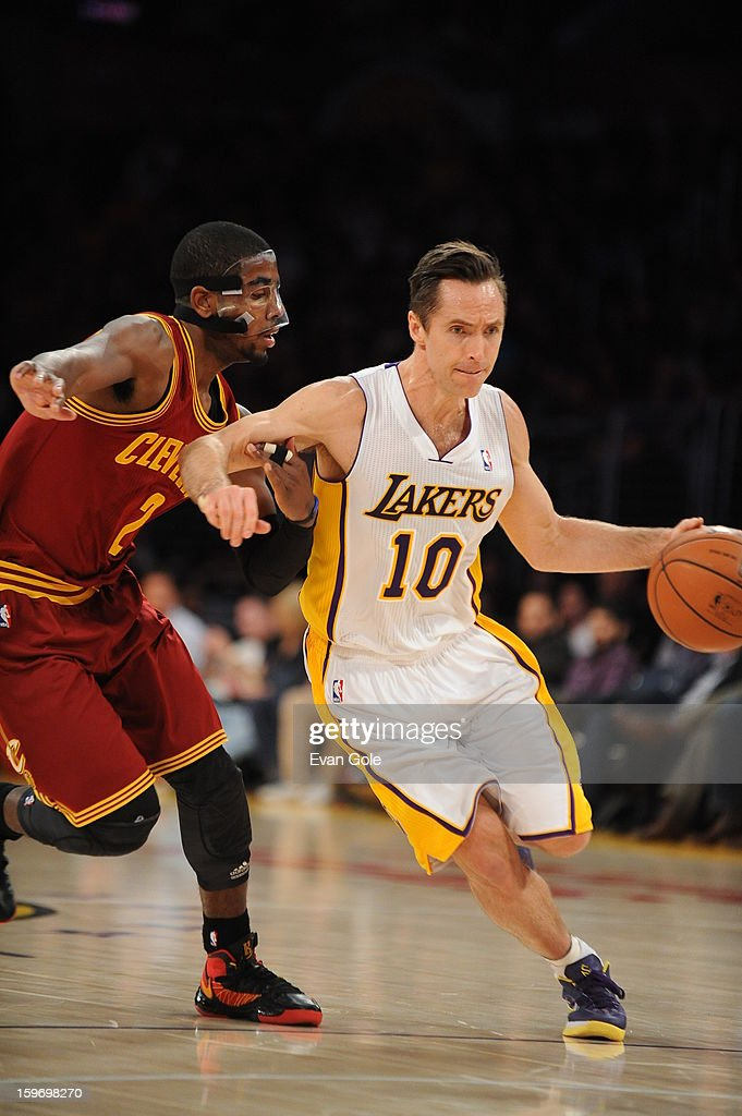 <a gi-track='captionPersonalityLinkClicked' href=/galleries/search?phrase=Steve+Nash+-+Basketball+Player&family=editorial&specificpeople=201513 ng-click='$event.stopPropagation()'>Steve Nash</a> #10 of the Los Angeles Lakers drives to the basket against <a gi-track='captionPersonalityLinkClicked' href=/galleries/search?phrase=Kyrie+Irving&family=editorial&specificpeople=6893971 ng-click='$event.stopPropagation()'>Kyrie Irving</a> #2 of the Cleveland Cavaliers at Staples Center on January 13, 2013 in Los Angeles, California.