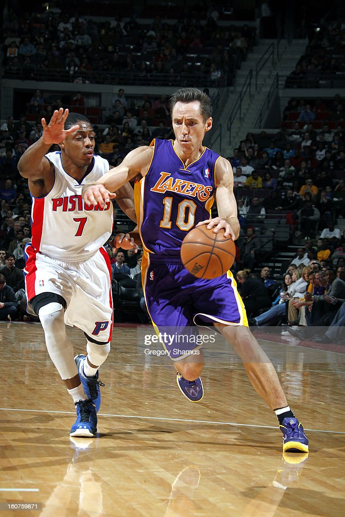 Steve Nash #10 of the Los Angeles Lakers drives to the basket against Brandon Knight #7 of the Detroit Pistons on February 3, 2013 at The Palace of Auburn Hills in Auburn Hills, Michigan.