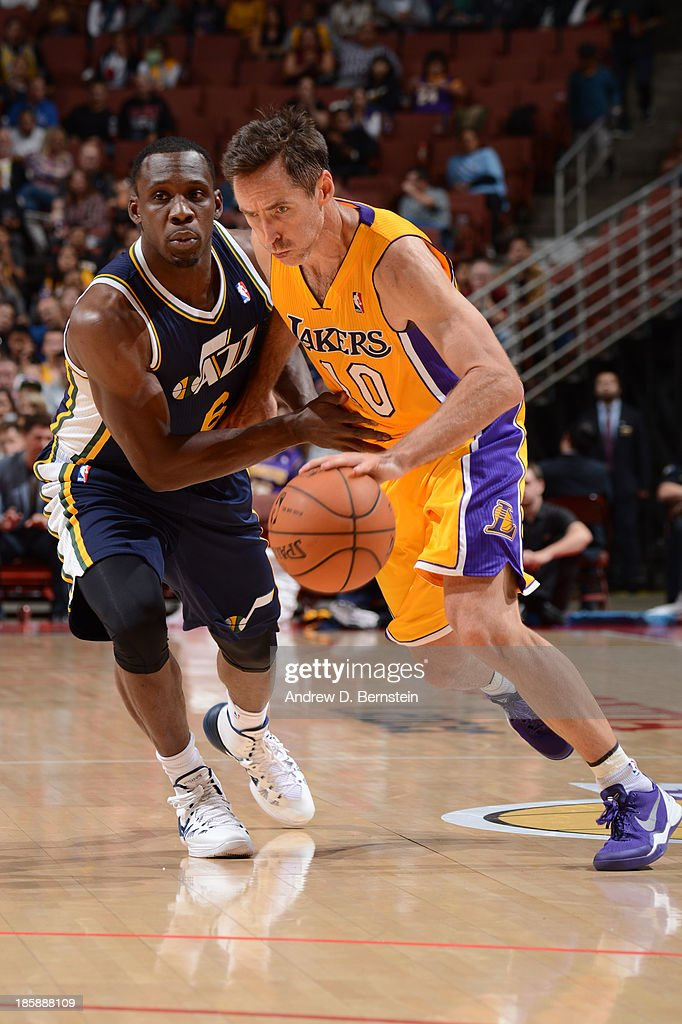 <a gi-track='captionPersonalityLinkClicked' href=/galleries/search?phrase=Steve+Nash+-+Basketball+Player&family=editorial&specificpeople=201513 ng-click='$event.stopPropagation()'>Steve Nash</a> #10 of the Los Angeles Lakers drives to the basket against <a gi-track='captionPersonalityLinkClicked' href=/galleries/search?phrase=Lester+Hudson&family=editorial&specificpeople=5960156 ng-click='$event.stopPropagation()'>Lester Hudson</a> #6 of the Utah Jazz during a preseason game at the Honda Center in Anaheim, California on October 25, 2013.