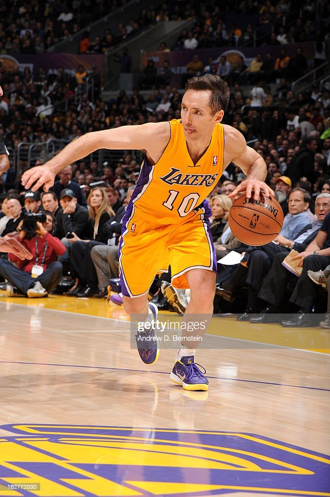 Steve Nash #10 of the Los Angeles Lakers drives to the basket against the New Orleans Hornets at Staples Center on January 29, 2013 in Los Angeles, California.