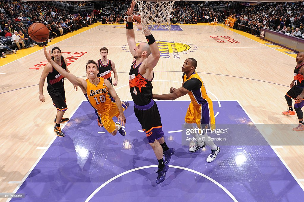 <a gi-track='captionPersonalityLinkClicked' href=/galleries/search?phrase=Steve+Nash&family=editorial&specificpeople=201513 ng-click='$event.stopPropagation()'>Steve Nash</a> #10 of the Los Angeles Lakers drives to the basket against the Phoenix Suns at Staples Center on February 12, 2013 in Los Angeles, California.