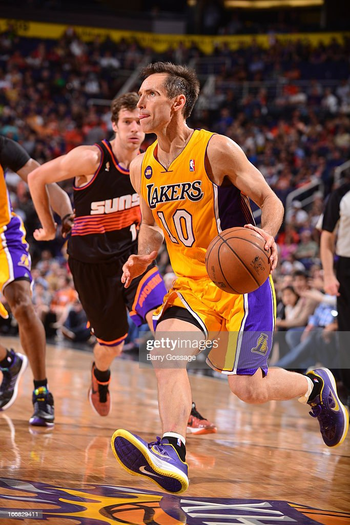 <a gi-track='captionPersonalityLinkClicked' href=/galleries/search?phrase=Steve+Nash+-+Basketball+Player&family=editorial&specificpeople=201513 ng-click='$event.stopPropagation()'>Steve Nash</a> #10 of the Los Angeles Lakers drives to the basket against the Phoenix Suns on March 18, 2013 at U.S. Airways Center in Phoenix, Arizona.
