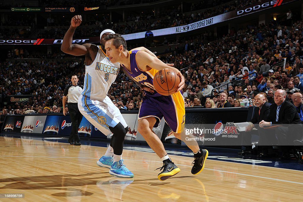 <a gi-track='captionPersonalityLinkClicked' href=/galleries/search?phrase=Steve+Nash&family=editorial&specificpeople=201513 ng-click='$event.stopPropagation()'>Steve Nash</a> #10 of the Los Angeles Lakers drives to the basket around <a gi-track='captionPersonalityLinkClicked' href=/galleries/search?phrase=Ty+Lawson&family=editorial&specificpeople=4024882 ng-click='$event.stopPropagation()'>Ty Lawson</a> #3 of the Denver Nuggets on December 26, 2012 at the Pepsi Center in Denver, Colorado.