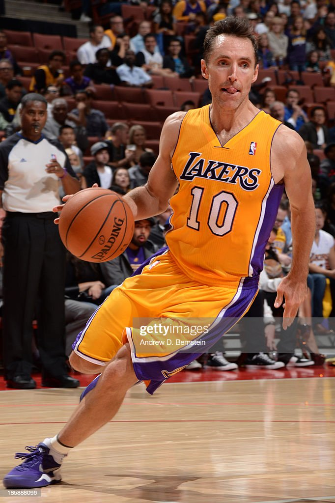 <a gi-track='captionPersonalityLinkClicked' href=/galleries/search?phrase=Steve+Nash+-+Basketball+Player&family=editorial&specificpeople=201513 ng-click='$event.stopPropagation()'>Steve Nash</a> #10 of the Los Angeles Lakers drives to the basket during a preseason game against the Utah Jazz at the Honda Center in Anaheim, California on October 25, 2013.