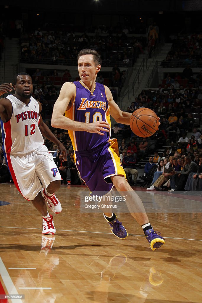 Steve Nash #10 of the Los Angeles Lakers handles the ball against Will Bynum #12 of the Detroit Pistons on February 3, 2013 at The Palace of Auburn Hills in Auburn Hills, Michigan.