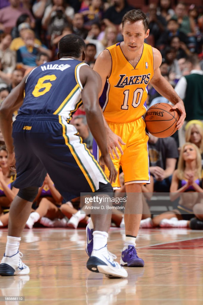 <a gi-track='captionPersonalityLinkClicked' href=/galleries/search?phrase=Steve+Nash+-+Basketball+Player&family=editorial&specificpeople=201513 ng-click='$event.stopPropagation()'>Steve Nash</a> #10 of the Los Angeles Lakers handles the basketball against <a gi-track='captionPersonalityLinkClicked' href=/galleries/search?phrase=Lester+Hudson&family=editorial&specificpeople=5960156 ng-click='$event.stopPropagation()'>Lester Hudson</a> #6 of the Utah Jazz during a preseason game at the Honda Center in Anaheim, California on October 25, 2013.