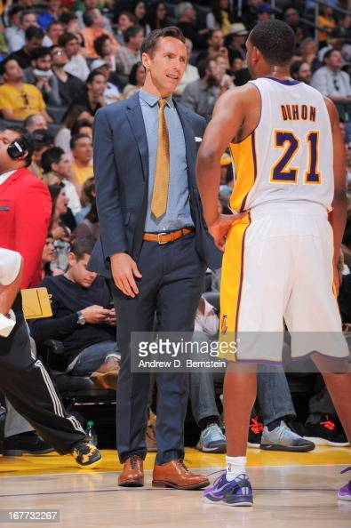Steve Nash of the Los Angeles Lakers in street clothes speaks with Chris Duhon as the team plays against the San Antonio Spurs in Game Four of the...