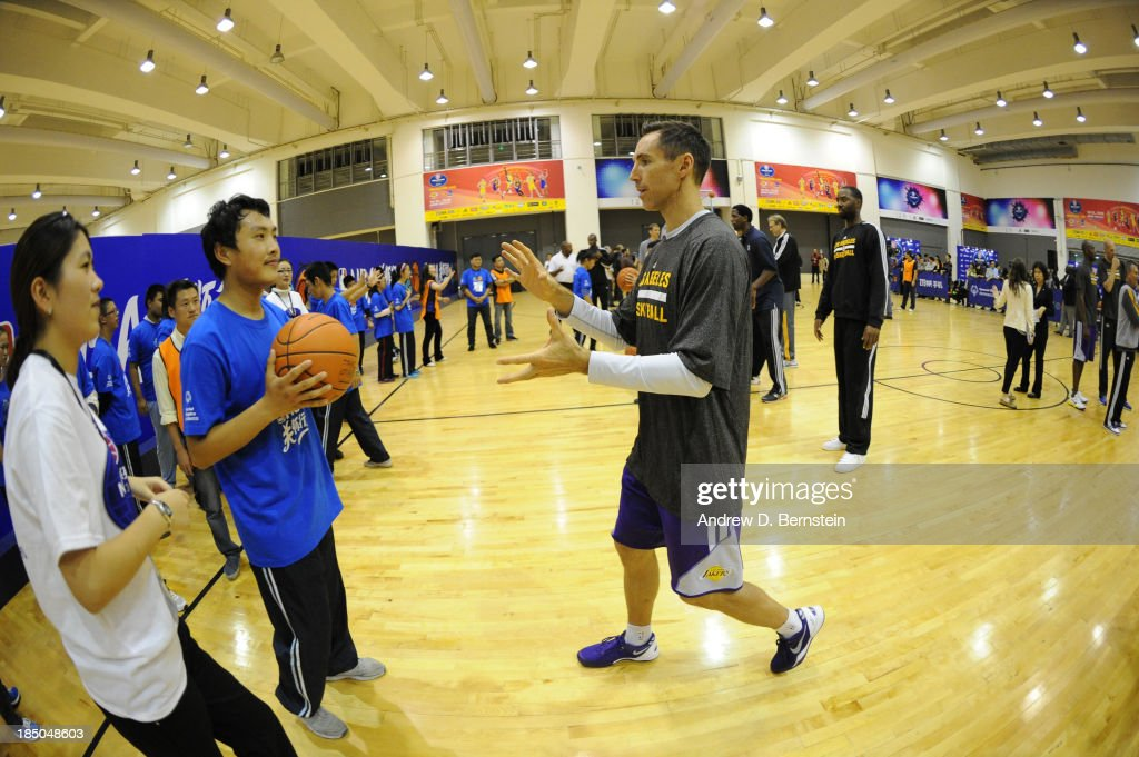 Steve Nash of the Los Angeles Lakers interacts with a participant during the NBA Cares Special Olympics Clinic as part of the 2013 Global Games on October 17, 2013 at the Oriental Sports Center in Shanghai, China.