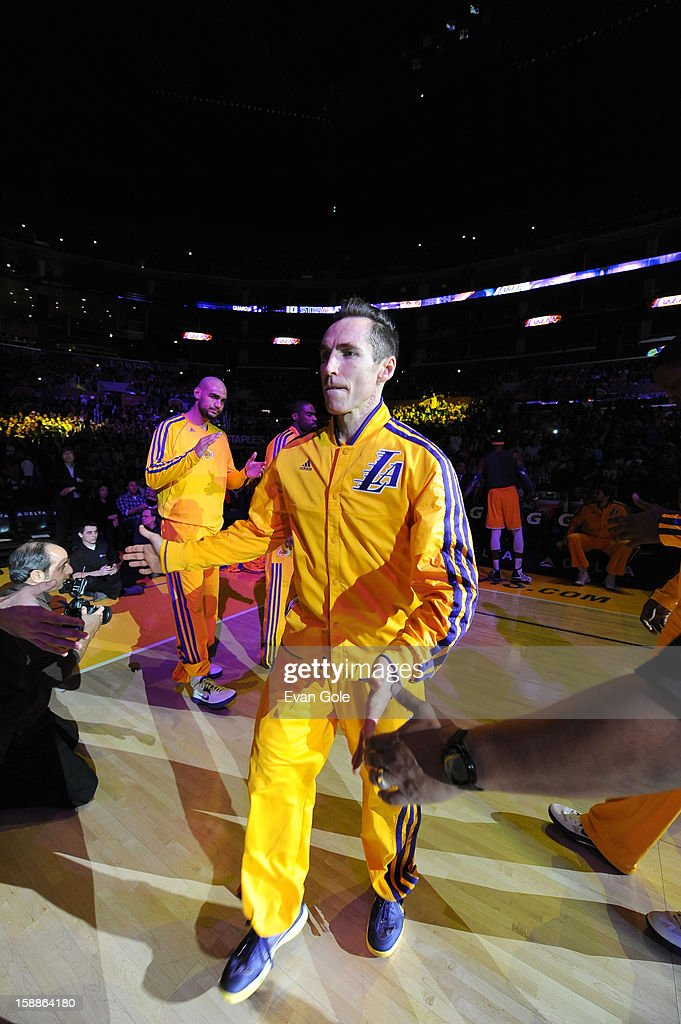 Steve Nash #10 of the Los Angeles Lakers is greeted as he enters the court during the game between the Philadelphia 76ers and the Los Angeles Lakers at Staples Center on January 1, 2013 in Los Angeles, California.