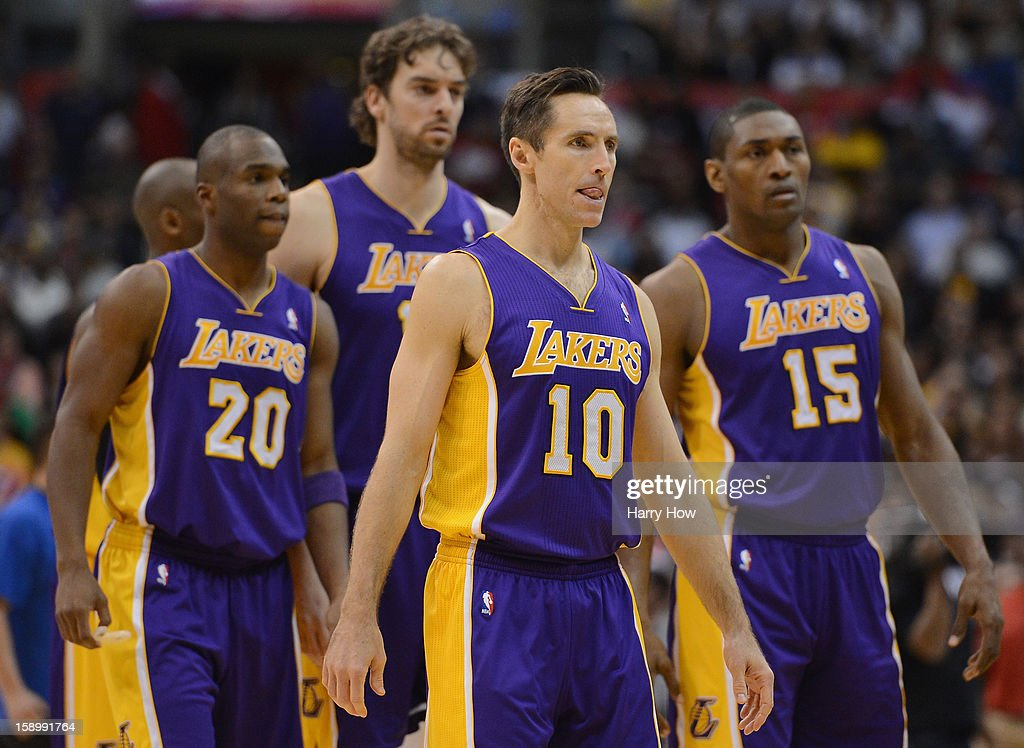 Steve Nash #10 of the Los Angeles Lakers leads Jodie Meeks #20, Pau Gasol #16 and Metta World Peace #15 off the court late in the fourth quarter after a timeout on way to losing 107-102 loss to the Los Angeles Clippers at Staples Center on January 4, 2013 in Los Angeles, California.