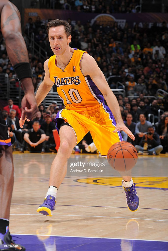 Steve Nash #10 of the Los Angeles Lakers looks to drive to the basket against the Phoenix Suns at Staples Center on February 12, 2013 in Los Angeles, California.