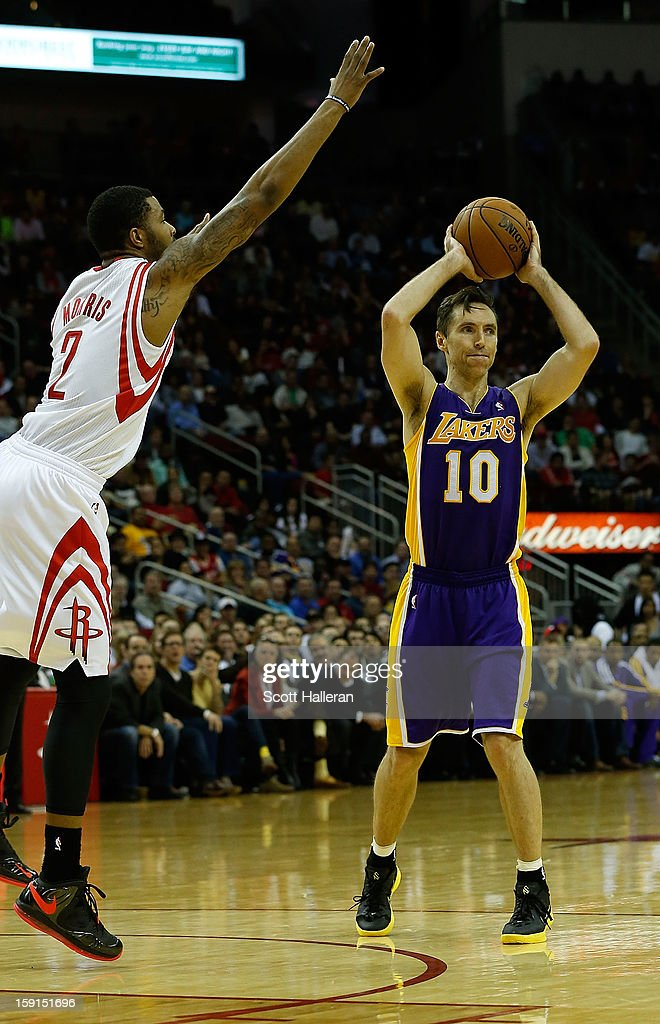 Steve Nash #10 of the Los Angeles Lakers looks to pass over Marcus Morris #2 of the Houston Rockets at Toyota Center on January 8, 2013 in Houston, Texas. Nash became just the fifth player in NBA history to reach 10,000 career assists Tuesday night.